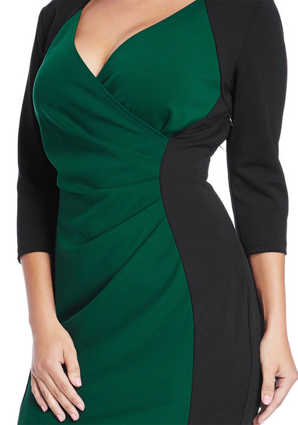 Close up shot of model in plus size green raglan sleeve dress