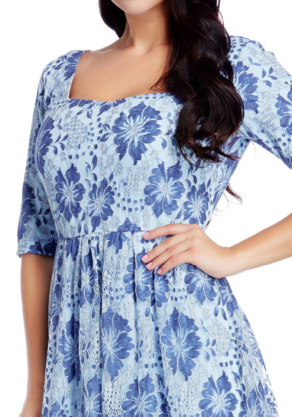 Close up shot of model in plus size light blue floral-print lace dress
