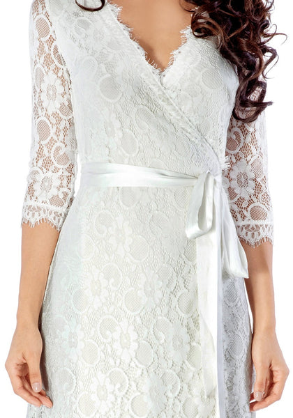 Close up shot of model in white lace overlay plunge wrap-style dress