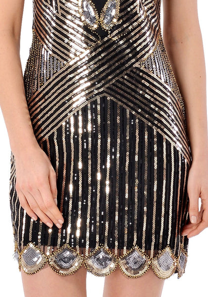 Close up shot of model wearing black scallop hem sequined flapper dress