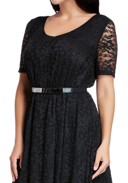 Close up shot of woman wearing plus size black lace midi dress