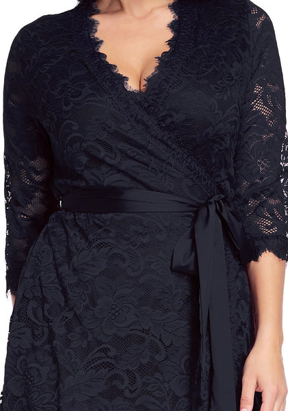 Close up shot of woman wearing plus size navy lace crop sleeves wrap dress