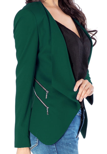 Close up side view of model in deep green draped blazer