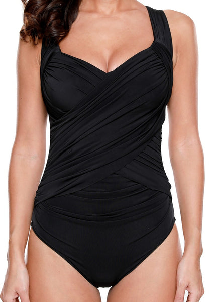 Close up view of black crossover ruched swimsuit