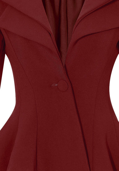 Close up view of burgundy double lapel fit-and-flare blazer