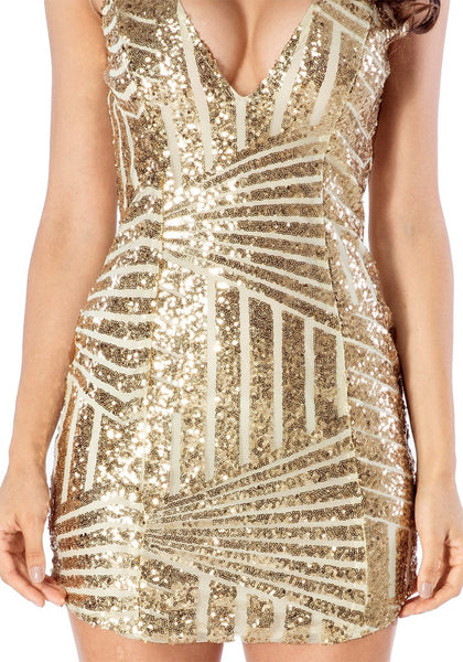 Close up view of gold sequin party dress