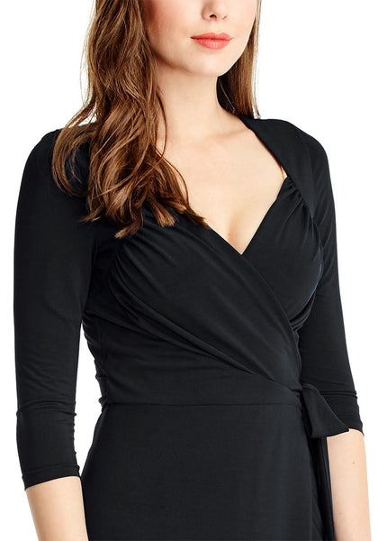 Close up view of model in black sweetheart neckline wrap dress