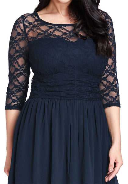 Close up view of model wearing plus size navy lace crop-sleeves skater dress