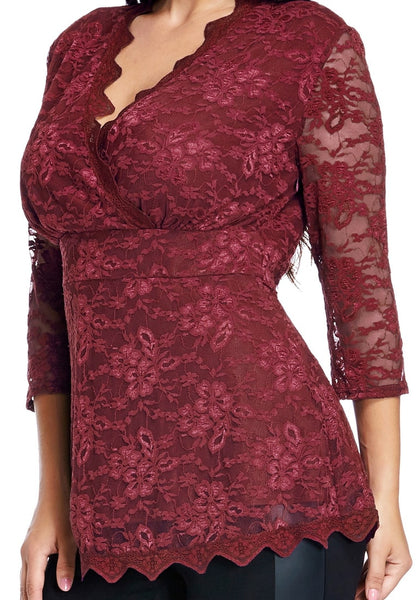 Close up view of plus size burgundy lace scallop blouse