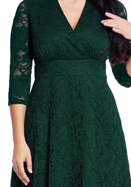 Close up view of plus size green lace surplice midi dress