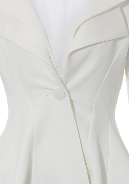 Close up view of white double lapel fit-and-flare blazer