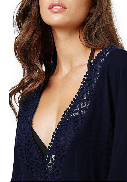 Closeup shot model in navy hollow out V-neck kaftan beach cover-up