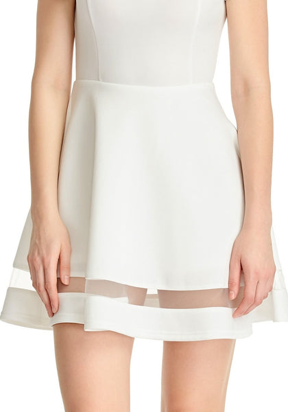 Closeup shot of model in White Mesh-Panel Short-Sleeve Skater Dress