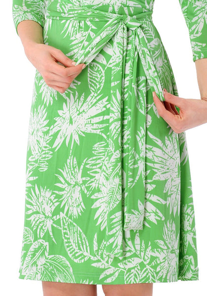 Closeup shot of model in light green plant-print crop sleeves faux wrap dress