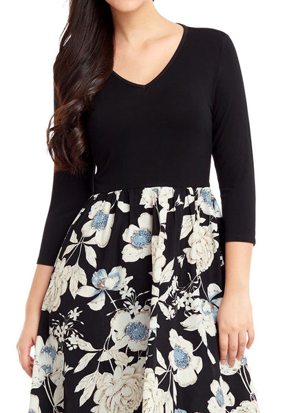 Closeup shot of model wearing black floral-bottom V neckline crop sleeves skater dress