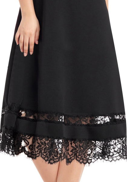 Closeup shot of model wearing black scallop hem lace panel skater dress