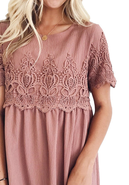 Closeup shot of model wearing deep blush hollow out lace keyhole-back shift dress