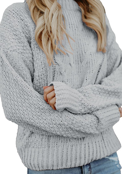 Closeup shot of model wearing grey crew neck velvet cable knit pullover sweater