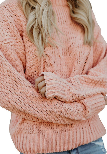 Closeup shot of model wearing pink crew neck velvet cable knit pullover sweater