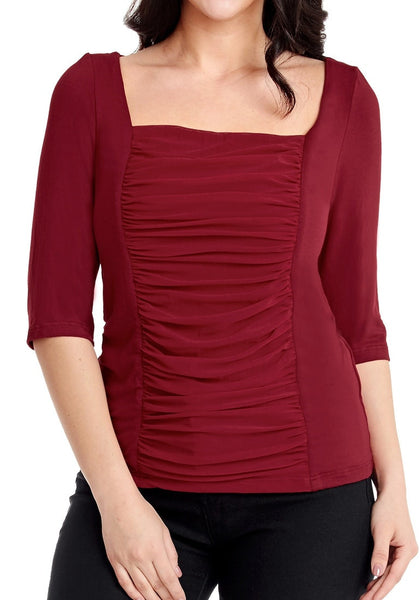 Closeup shot of model wearing plus size burgundy square-neckline ruched mesh-front top