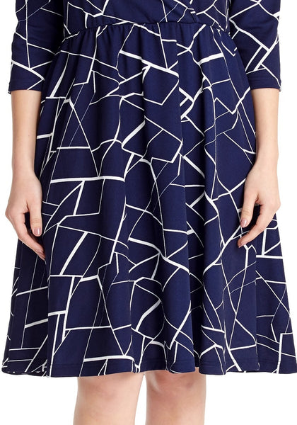 Closeup shot of model wearing plus size navy geometric-print crop sleeves faux wrap dress