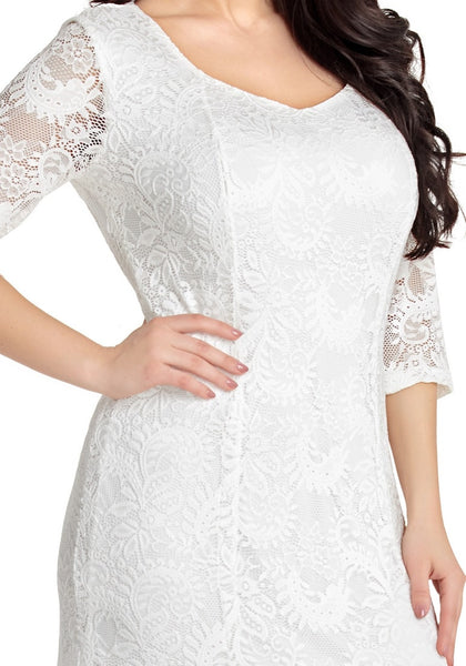Closeup shot of white floral lace overlay sweetheart neckline maxi dress' hemline