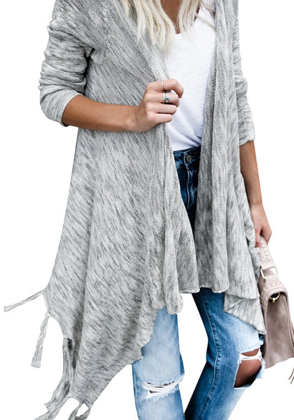 Closeup shot of woman in grey long sleeves knitted open front tassel cardigan