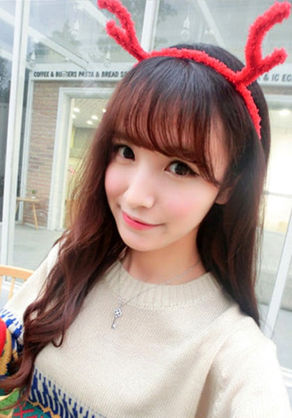 Cute model in red plush antler headband