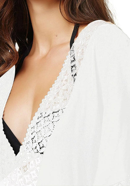 Details of white hollow out V-neck kaftan beach cover-up