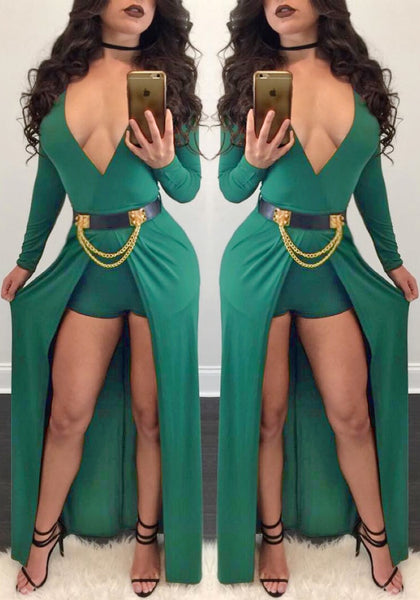 Double mirror shot of woman in green wrap plunge-neck belted romper dress