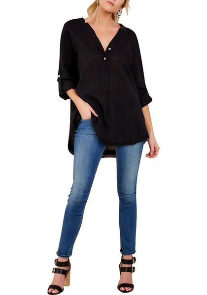 Front full body shot of model in black V-neckline roll-tab sleeves loose tunic top