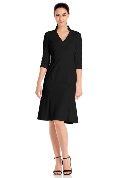 Front full body shot of model in black stand collar crop sleeves dress