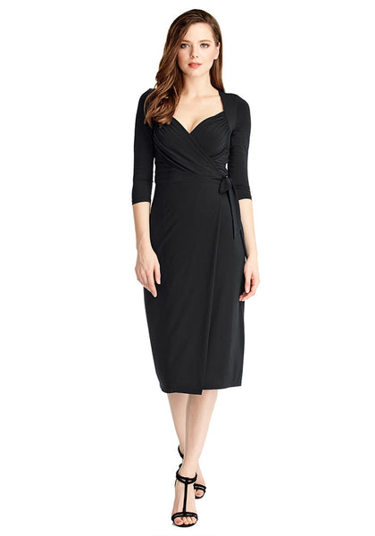 Front full body shot of model in black sweetheart neckline wrap dress