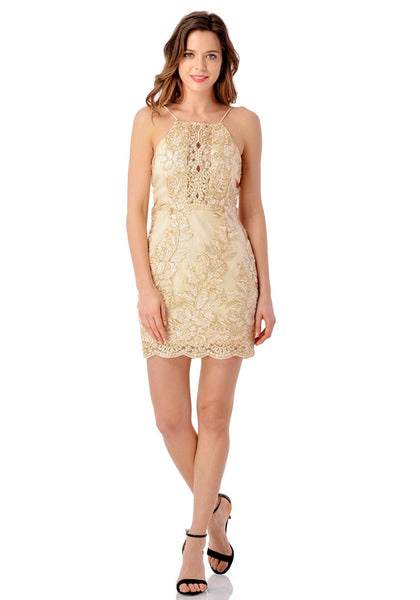Front full body shot of model in champagne floral embroidered scallop slip dress