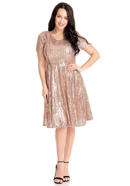 Front full body shot of model in champagne sequined short sleeves skater dress