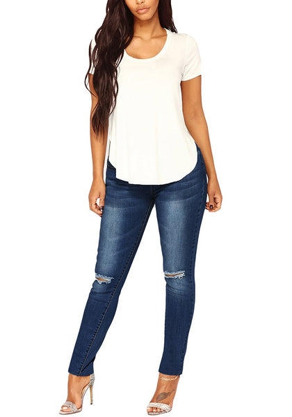 Front full body shot of model in dark blue drawstring-waist washout ripped skinny jeans