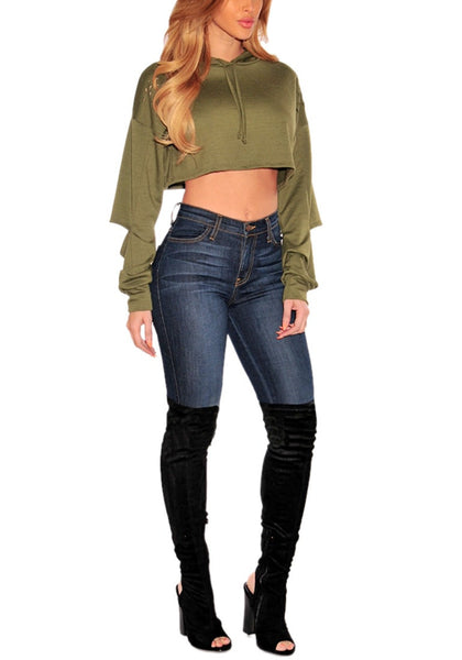 Front full body shot of model in olive green ripped hoodie crop top