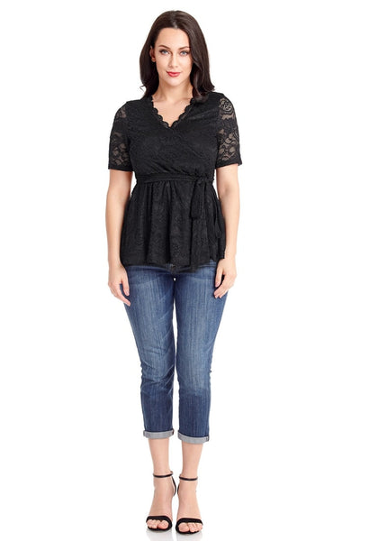 Front full body shot of model in plus size black scallop-neck lace blouse