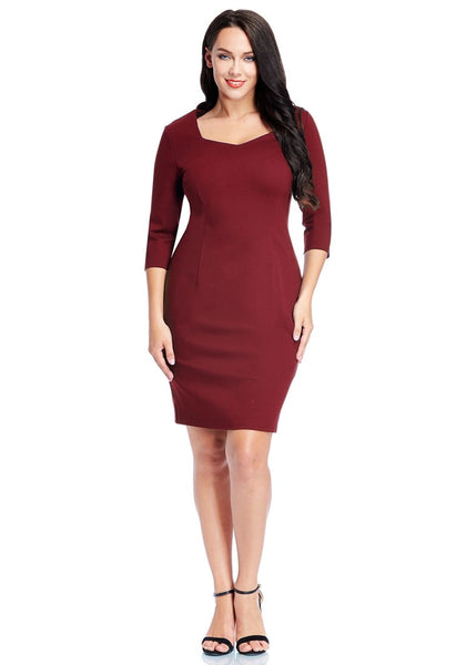 Front full body shot of model in plus size burgundy decollete neckline pencil dress