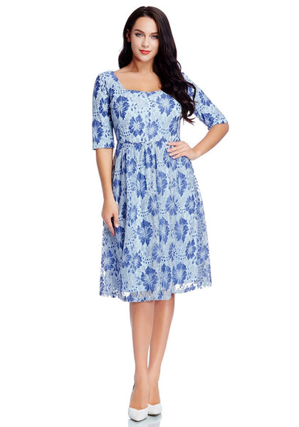 Front full body shot of model in plus size light blue floral-print lace dress