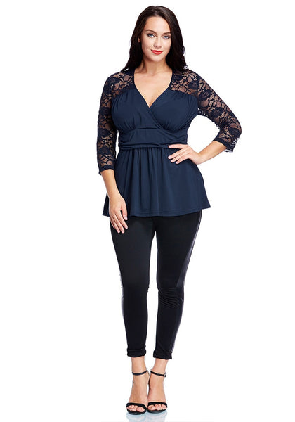 Front full body shot of model in plus size navy lace navy wrap top