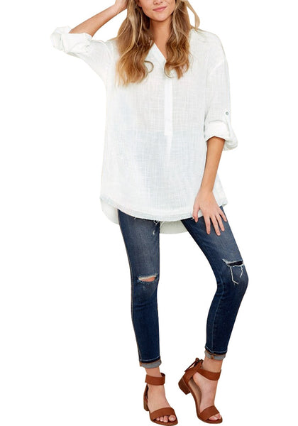 Front full body shot of model in white  V-neckline roll-tab sleeves loose tunic top