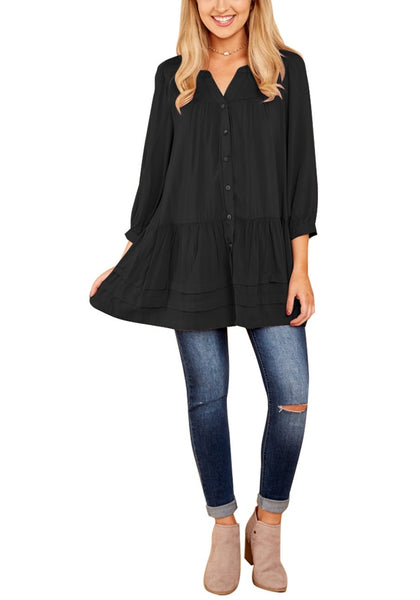 Front full body shot of model wearing black button-front puffed sleeves tunic
