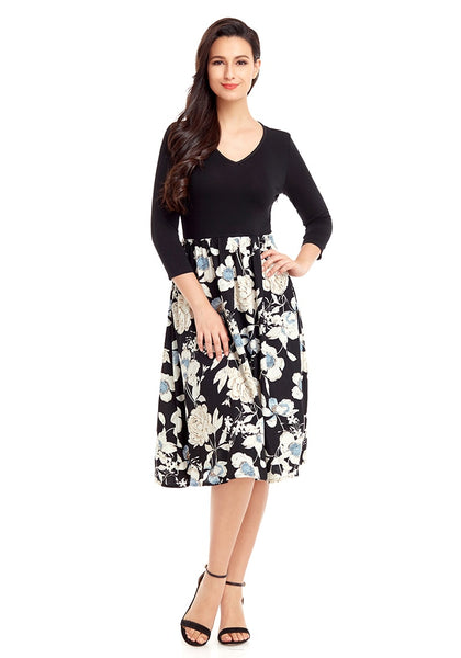 Front full body shot of model wearing black floral-bottom V neckline crop sleeves skater dress