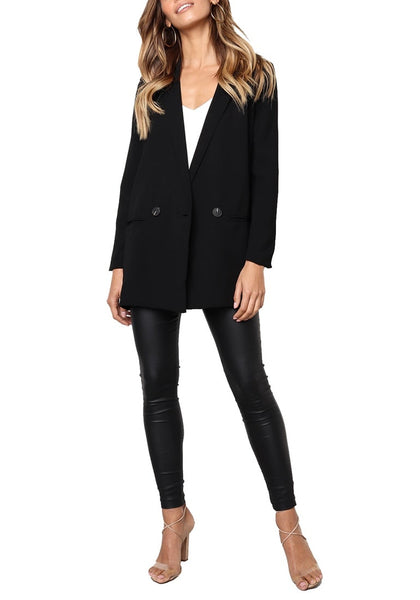 Front full body shot of model wearing black mock-pocket double-breasted lapel blazer
