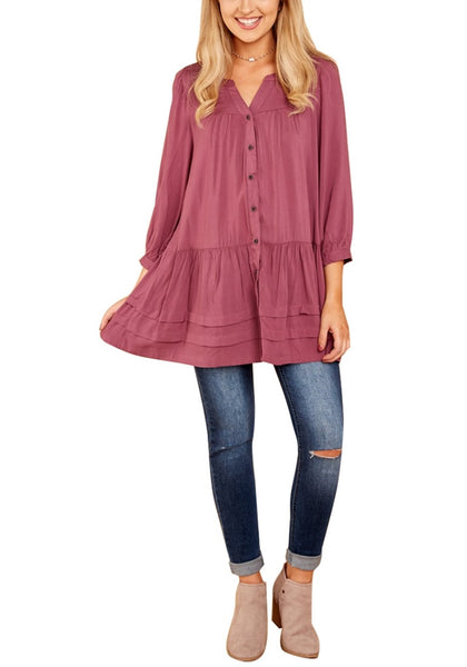 Front full body shot of model wearing deep blush button-front puffed sleeves tunic