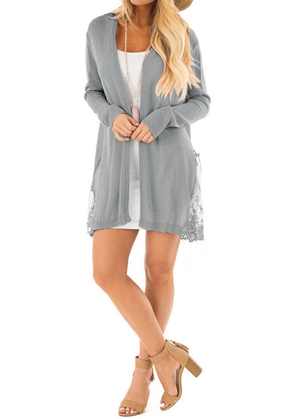 Front full body shot of model wearing grey long sleeves crochet lace open-front cardigan