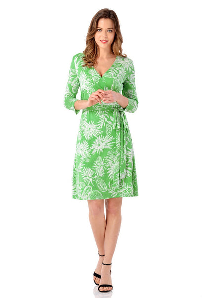 Front full body shot of model wearing light green plant-print crop sleeves faux wrap dress