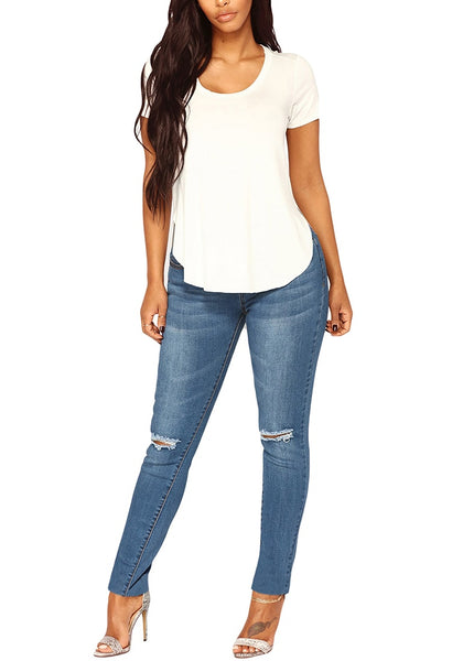 Front full body shot of model wearing medium blue drawstring-waist washout ripped skinny jeans