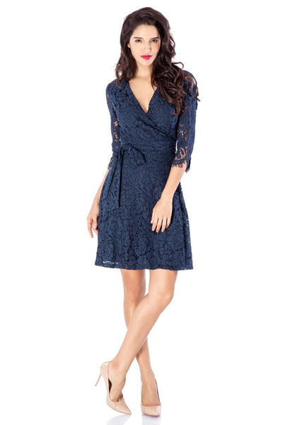 Front full body shot of model wearing navy floral lace overlay wrap dress